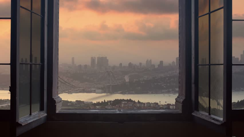 Timelapse of istanbul city skyline cityscape starting at the sunset ending at night as seen from a window camera moving out the house | Shutterstock HD Video #13383032