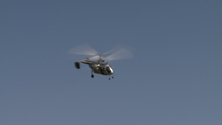 View of helicopter quickly flying over airfield