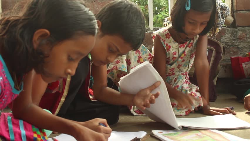 Girl students sketch and draw at a school for underprivileged kids in Bengal, India.