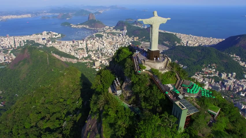 Aerial view of Christ the Redeemer statue and Sugarloaf Mountain in Rio de Janeiro, Brazil.  | Shutterstock HD Video #13439705