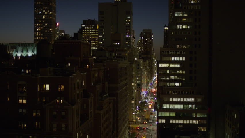 High angle wide shot of cityscape at night / New York, New York, United States | Shutterstock HD Video #13445006