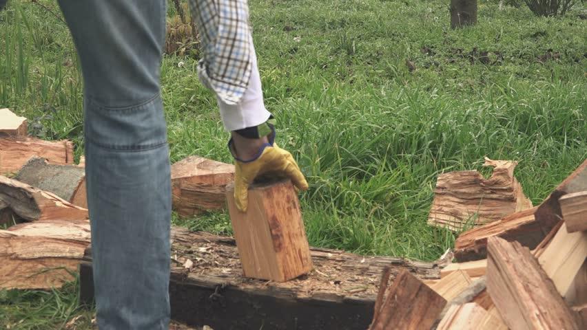 lumberjack cutting firewood with axe in backyard hd stock video clip