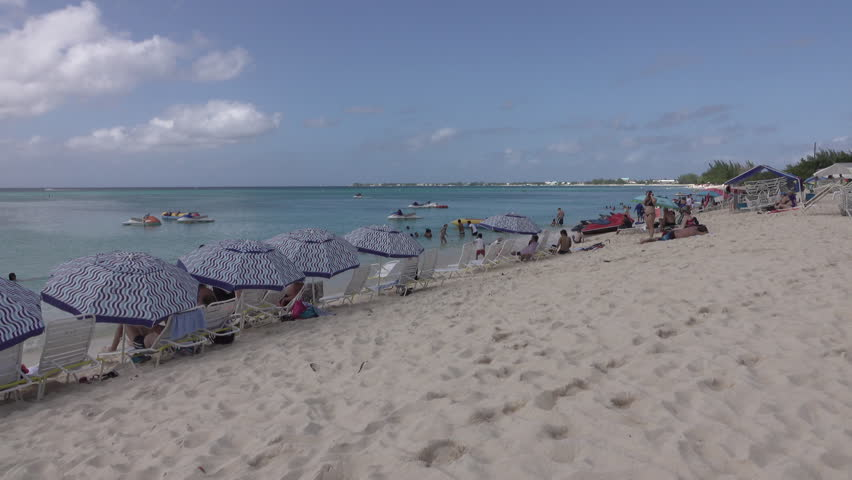 GRAND CAYMAN - NOV 2015: Grand Cayman Island Caribbean Ocean sandy beach paradise. Tourism and off shore banking are main economic stimulus. Beach and resorts cater to tourists. Vacation destination.