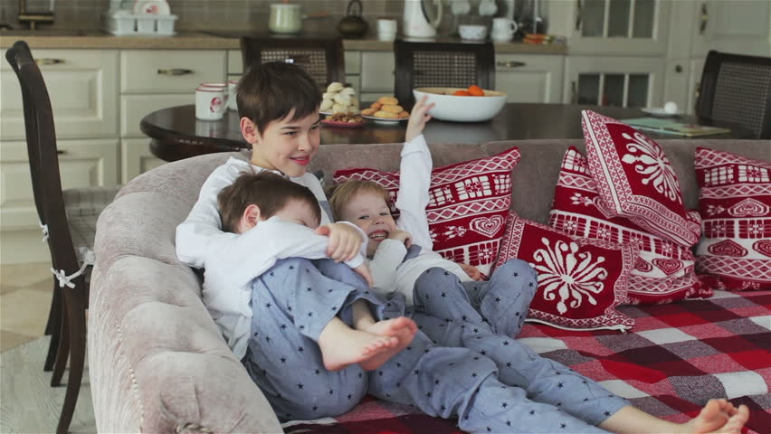 Three Brothers In Pajamas Sitting On The Couch Dining Room