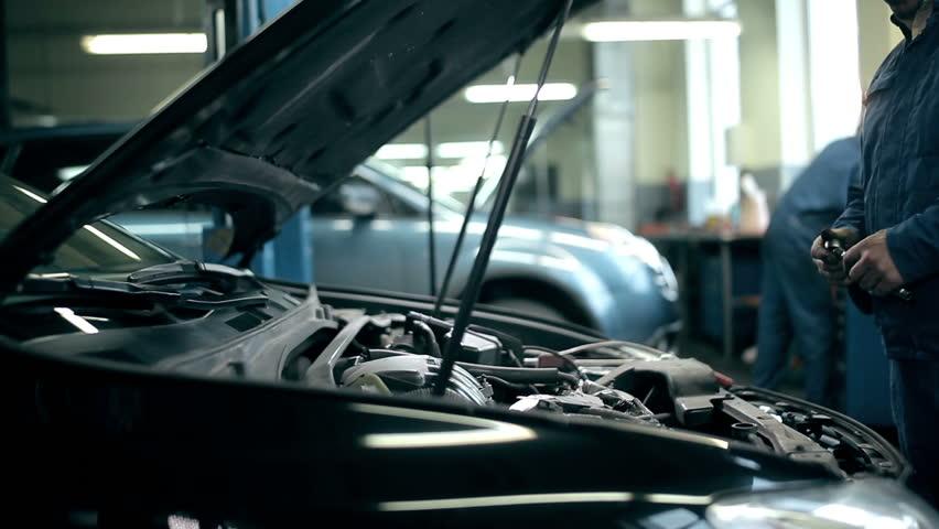 Proffesional car maintenance at repair shop - HD stock footage clip