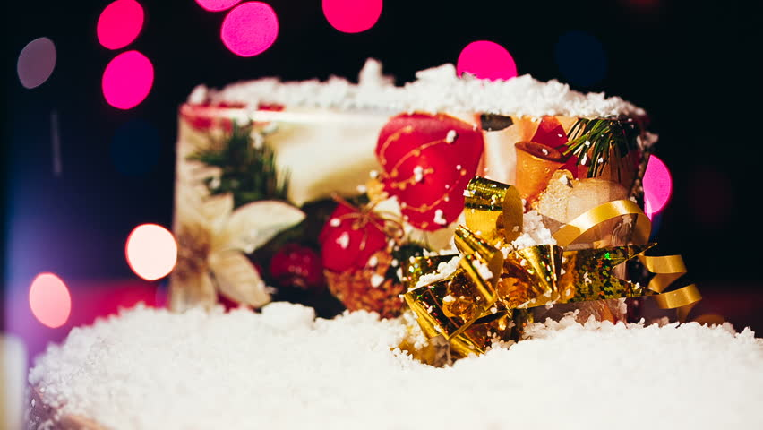 Imitation of the falling snow on a christmas gift. Close up video. | Shutterstock HD Video #13520012