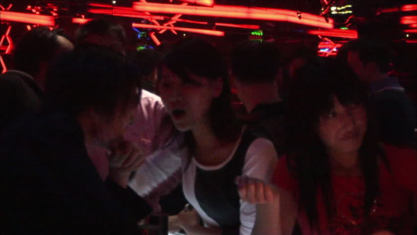 Shanghai, China - December 2007: Chinese girls at the bar playing drinking games with dice, in a Shanghai nightclub, China. - HD stock video clip