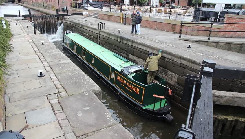 MANCHESTER, UK - APRIL 21, 2013: People visit Castlefield canal area in Manchester, UK. Castlefield is an Urban Heritage Park since 1982.