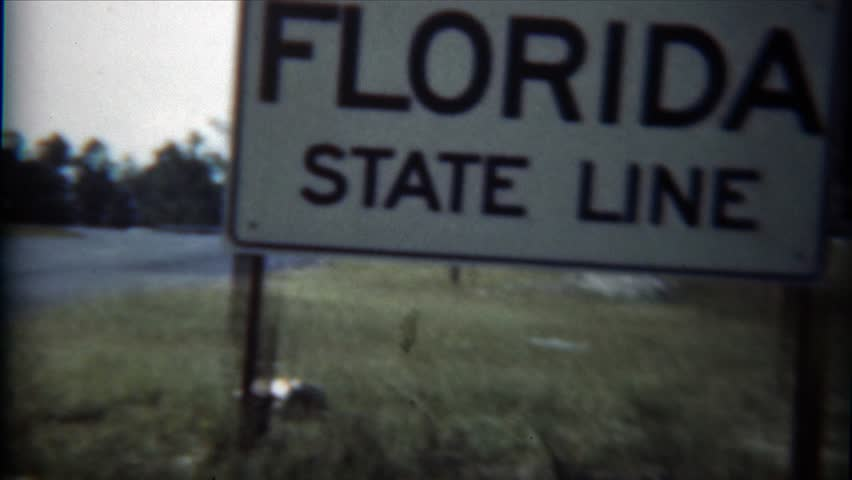 JACKSONVILLE, FLORIDA 1954: Florida state line black classic car parked documented. - 4K stock video clip