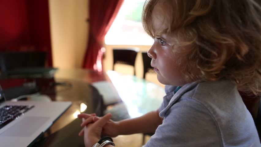 Toddler boy watching a movie on a laptop computer | Shutterstock HD Video #13575191