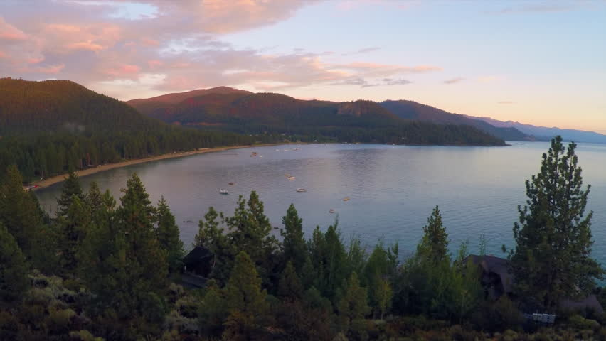 LAKE TAHOE, NEVADA - CIRCA 2015 - An aerial shot over a romantic couple looking out over Lake Tahoe, Nevada. | Shutterstock HD Video #13596413