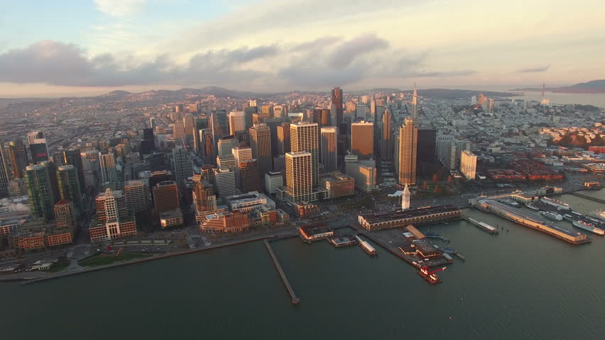4K Aerial drone shot San Francisco high view above buildings embarcadero sun #13597907