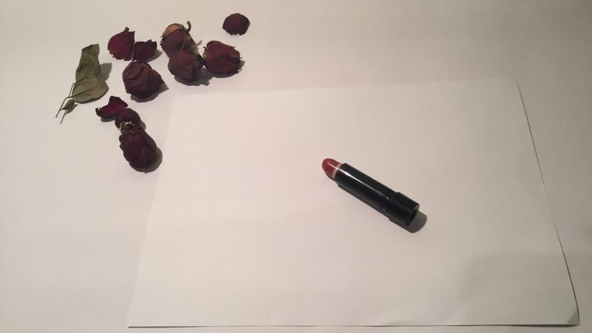 Writing 201 by hand with lipstick. | Shutterstock HD Video #13629902