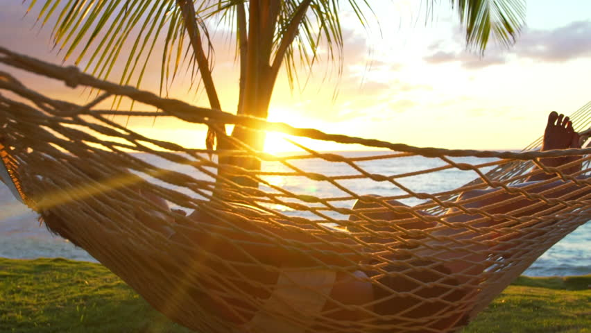 Romantic couple relaxing in tropical hammock at sunset. Summer Luxury Vacation. SLOW MOTION. | Shutterstock HD Video #13634249
