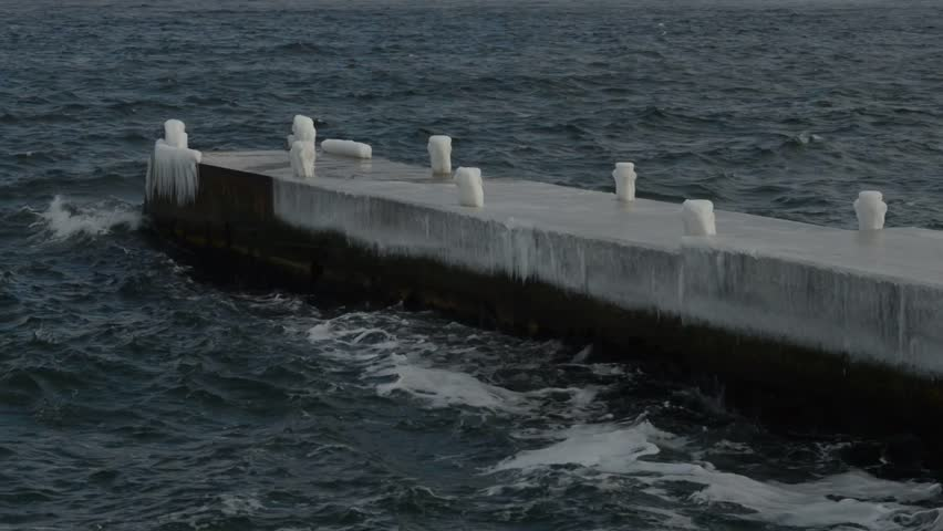 winter waves rolled on the pier - HD stock footage clip
