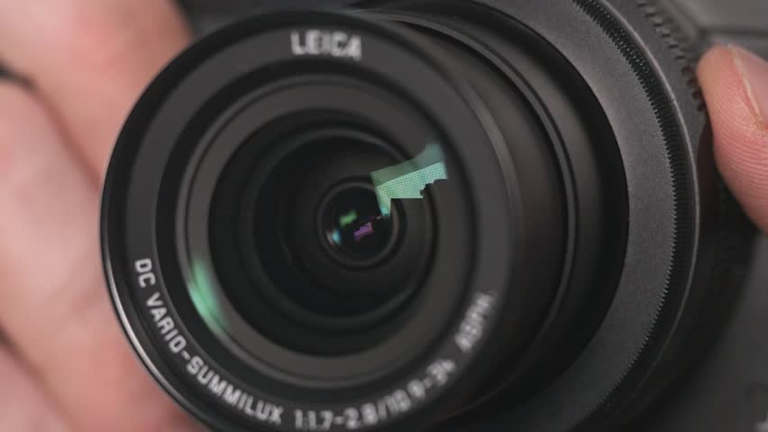 MONTREAL, CANADA - December 2015 : Lens of a digital camera zooming to ... Video Camera Lens Reflection