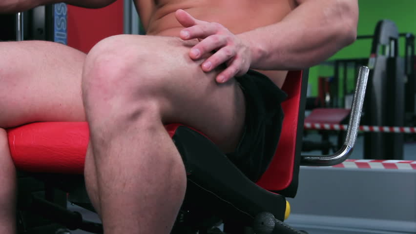 Workout for young bodybuilder. Exercises for legs with exercise equipment closeup