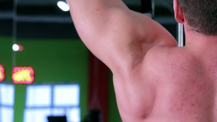 Workout for young bodybuilder. Exercises for arms and back with exercise equipment closeup
