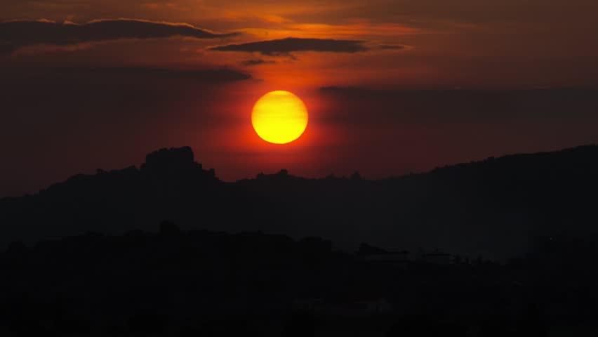 A beautiful sunset with clouds. Karnataka. Hampi. - 4K stock video clip