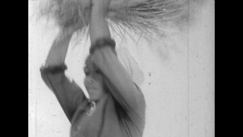 ASIA 1960s: Threshing the Grains from a Rice Crop - HD stock video clip