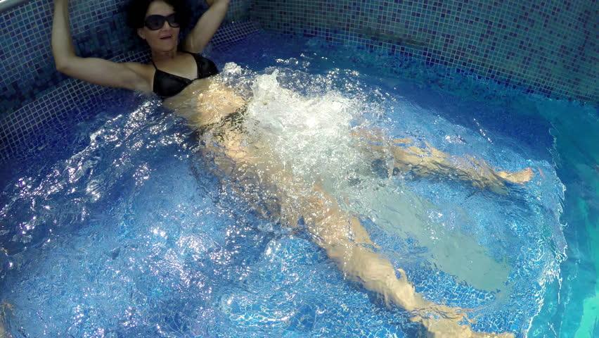 Children feet splashing in swimming pool in slow motion for Pool jets design