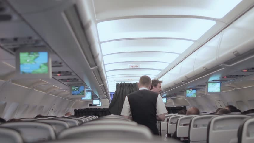 Cabin crew aboard flight catering service - Full HD. . LONDON, ENGLAND - 06 DECEMBER 2015; Stewards are members of an aircrew employed by airlines to ensure the safety and comfort of passengers. | Shutterstock HD Video #13861985