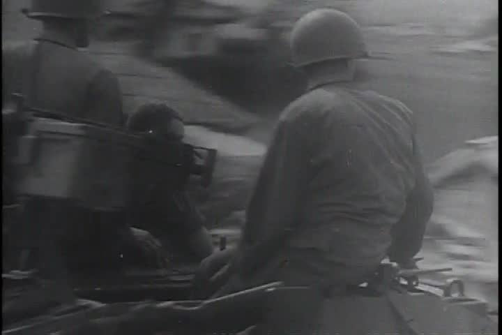 CIRCA 1970s - Cannons are fired, soldiers use machine guns and other weaponry in the 1970s.   Shutterstock HD Video #13890335