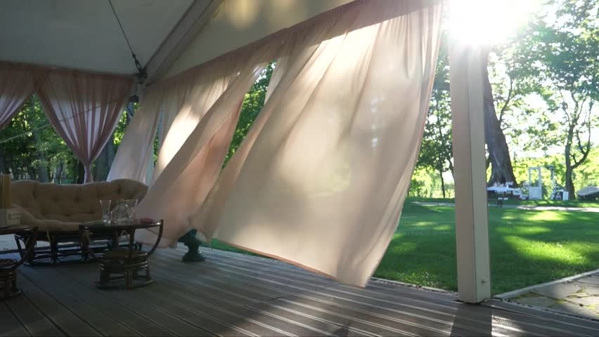 Wind blowing sheer curtain in window stock footage video 2096948