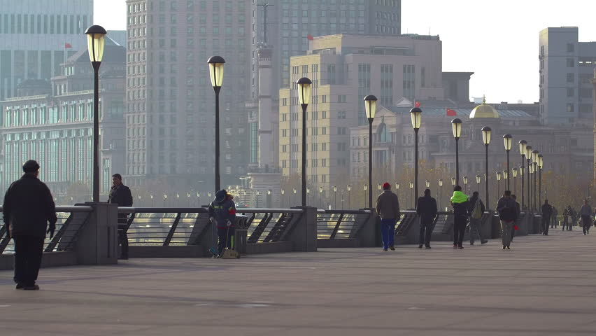 SHANGHAI - CIRCA 2015: People walking along The Bund in the morning in Shanghai
