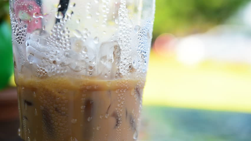 water drops on the plastic glass of iced coffee