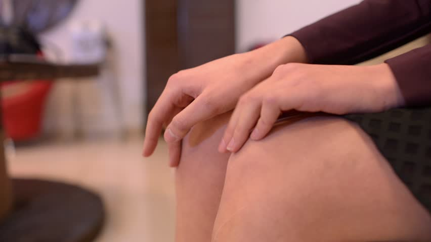 Women's fingers tapping on the bare knees - HD stock footage clip