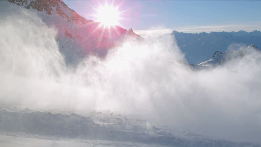 WS SLO MO Snow floating above snowcapped mountain at sunset / Tyrol, Austria | Shutterstock HD Video #14026541
