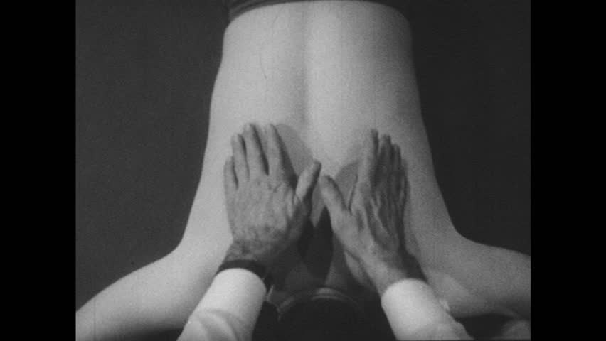 UNITED STATES 1950s: View of hand's on man's back. - HD stock video clip
