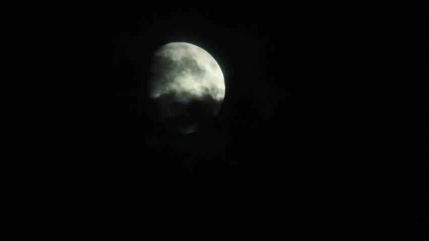 View moon at night sky in black clouds - HD stock footage clip