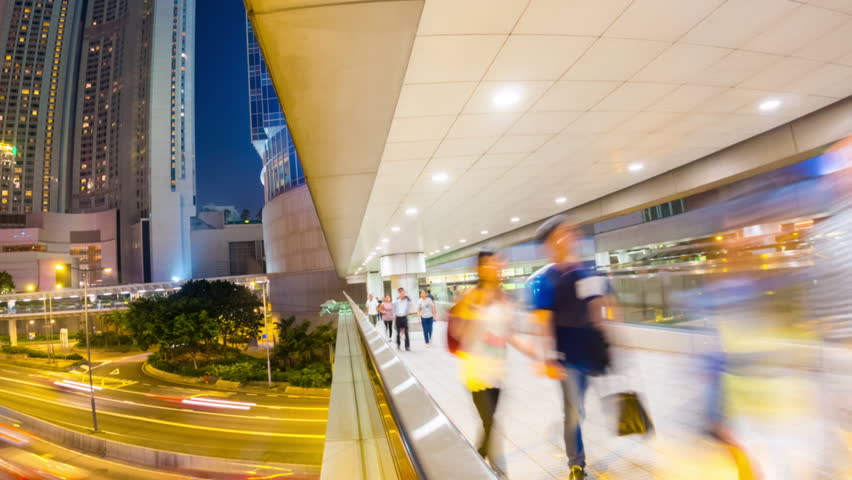 HONG KONG - 10 SEPT 2013: Timelapse view of people and traffic on the streets Hong Kong city at Central. Hong Kong is a major financial hub in the Asia region on 10 September 2013 in Hong Kong, China - HD stock video clip