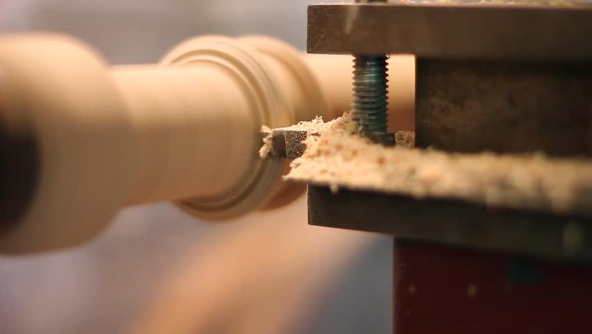 Carpenter scrape on the lathe a piece of furniture