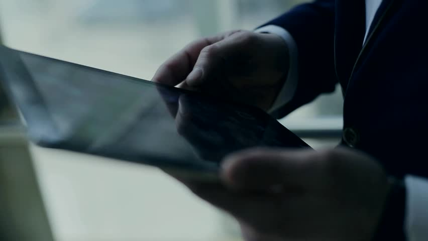 and successful business man with a phone and a tablet - HD stock footage clip