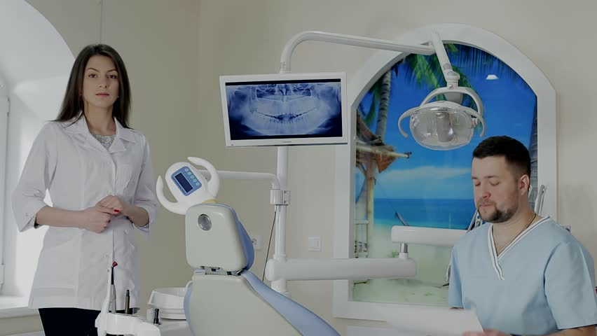 dentist talking to an assistant - HD stock footage clip