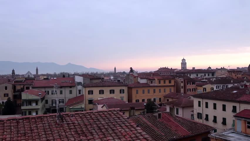 Video clip of sunrise above the roofs of Pisa in Tuscany, Italy.