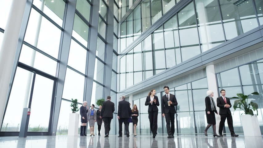 4k / Ultra HD version Diverse group of business people walking around a light and modern open plan office building. Shot on RED Epic - 4K stock video clip