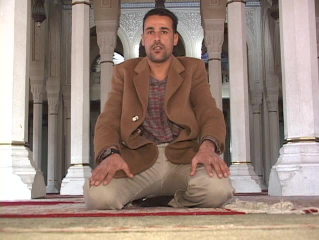 BAGHDAD - CIRCA 2003: An Iraqi Muslim prays in a mosque of Baghdad circa 2003 in Baghdad.