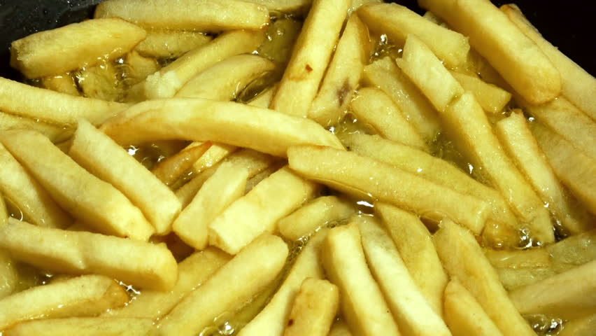 Stirring French French Fries With Spatula  - HD stock video clip