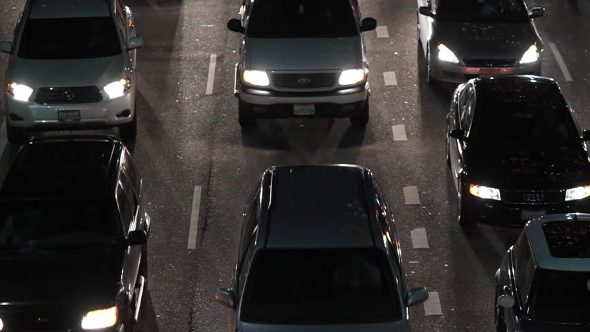 Los Angeles, CA - November, 2010: Stationary shot of slow moving traffic at night from above. - HD stock footage clip