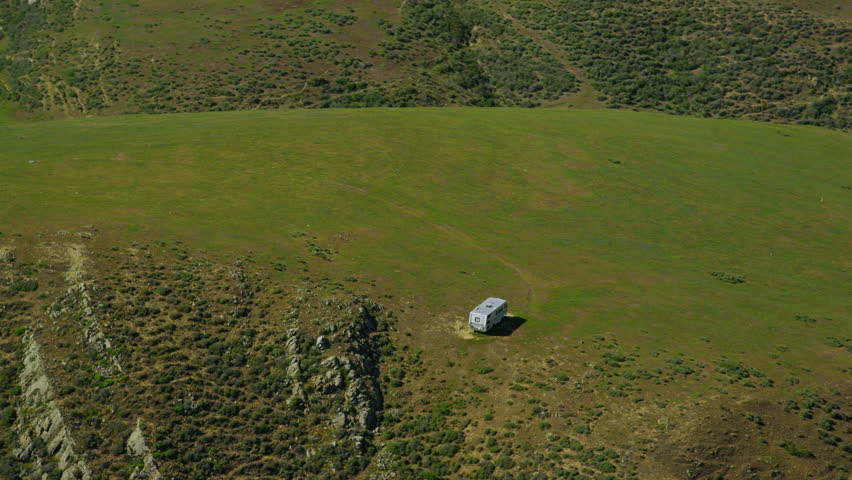 4k / Ultra HD version Aerial view of Motor Home on California Coastal road. Helicopter flying along Big Sur coast with the Pacific ocean and State park mountain range. Shot on RED Epic - 4K stock video clip