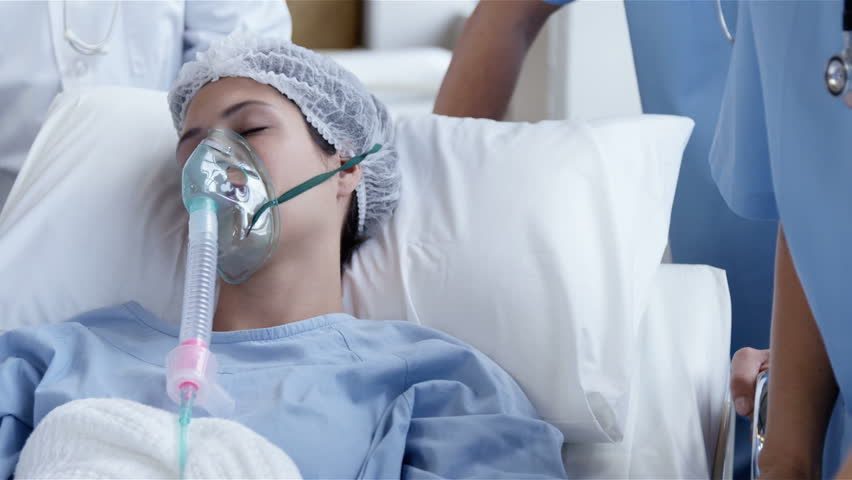 Female patient receiving artificial ventilation in hospital