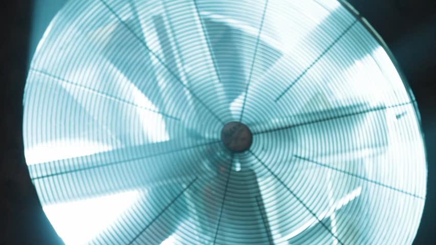 ECU slow rotating ventilation fan (light blue tinge) - HD stock footage clip