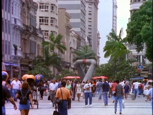 RIO DE JANEIRO - CIRCA 1990's: Shoppers and pedestrians walk through a shopping district circa 1990's in Rio De Janeiro, Brazil. - SD stock footage clip