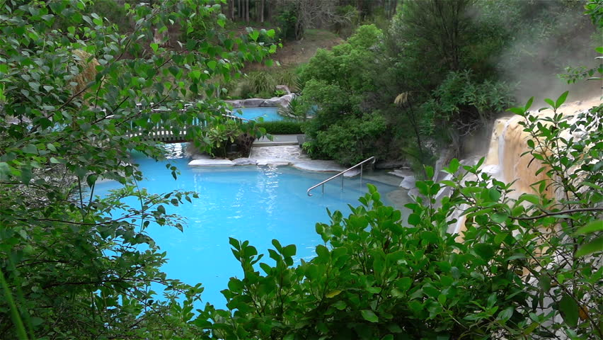 Hot geothermal spa pool steaming outdoors - HD stock video clip