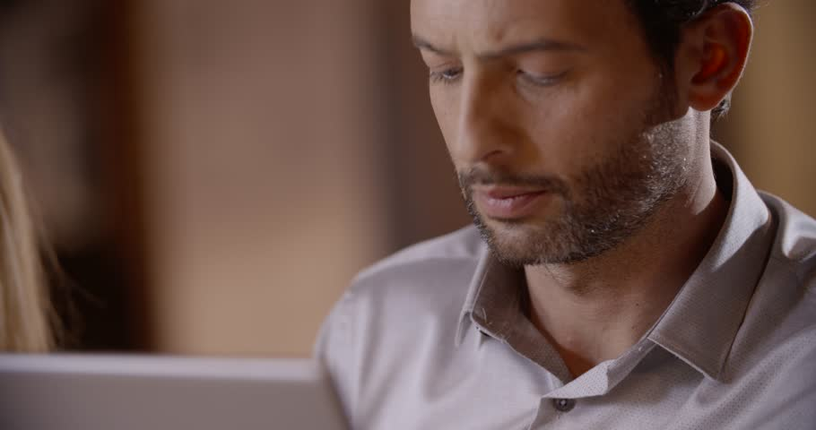 Young businessman looking at tablet in office portrait in slow motion (in real-time at 60 fps) - 4K stock video clip