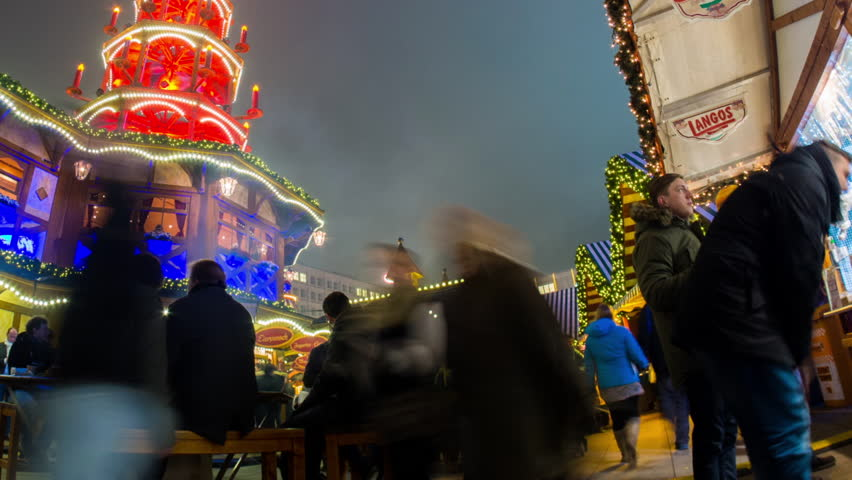 BERLIN - 02 DEC: Timelapse view of a Christmas Market near Alexanderplatz in central Berlin, a famous landmark where an annual market is held on 2 December 2013 in Berlin, Germany | Shutterstock HD Video #14254394